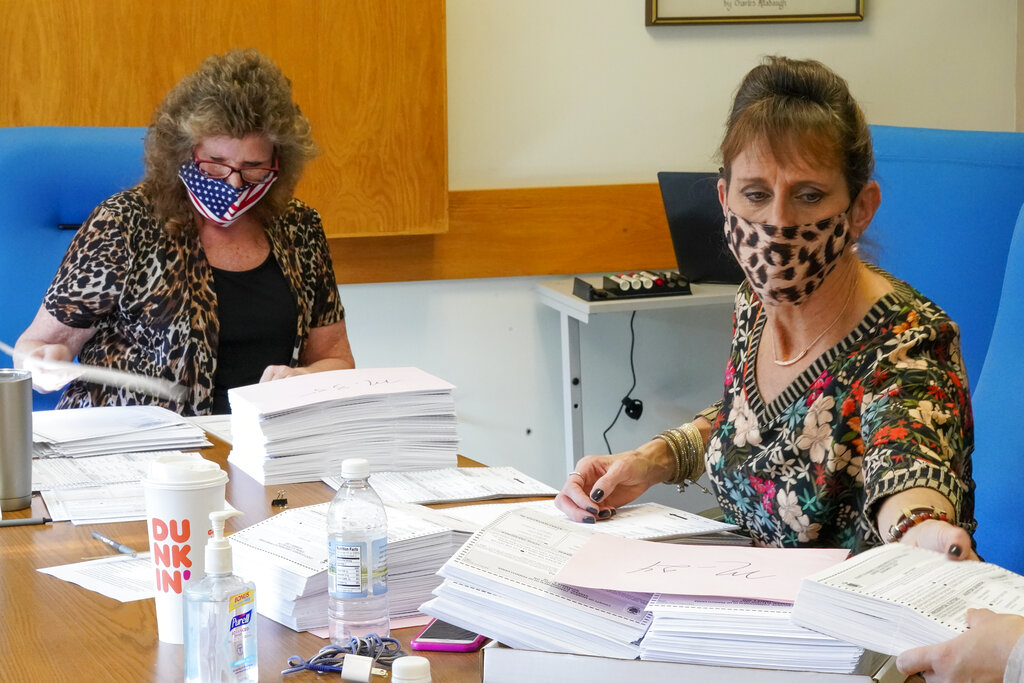 Monroe County municipal workers handle ballots Thursday as vote counting in the general election continues in Stroudsburg, Pa. (AP Photo/Mary Altaffer)