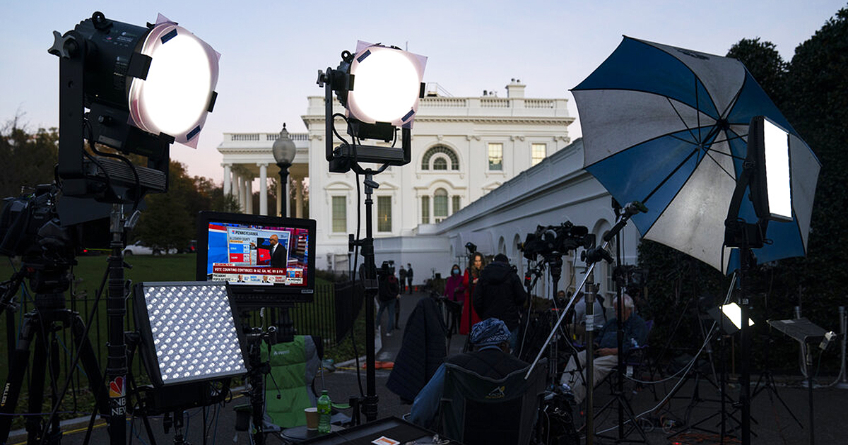 Media organizations set up outside the White House, Friday, Nov. 6, 2020, in Washington. (AP Photo/Evan Vucci)