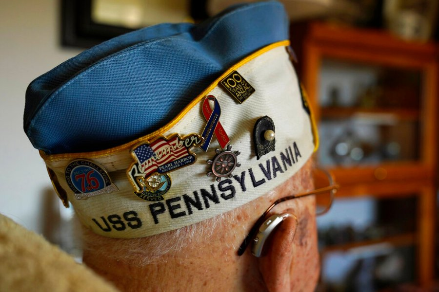 A number of commemorative pins adorn the hat of Mickey Ganitch, who served on the USS Pennsylvania during the 1941 attack on Pearl Harbor, at his home in San Leandro, Calif., on Nov. 20, 2020.