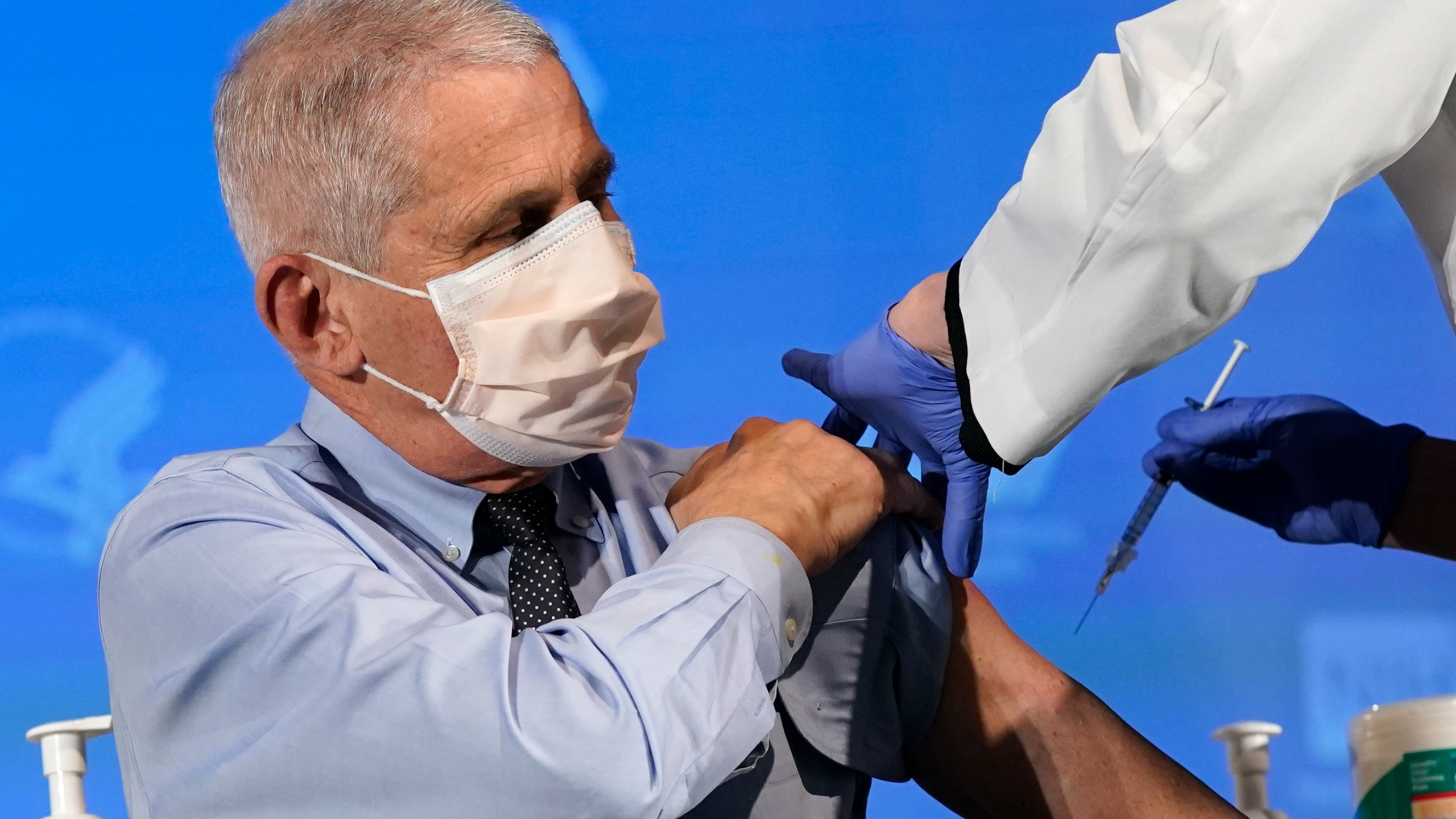 Dr. Anthony Fauci, director of the National Institute of Allergy and Infectious Diseases, prepares to receive his first dose of the COVID-19 vaccine at the National Institutes of Health on December 22, 2020 in Bethesda, Maryland. (Photo by Patrick Semansky-Pool/Getty Images)