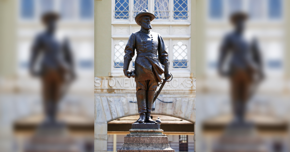 The statue of Confederate General Stonewall Jackson stands at the entrance to the barracks at the Virginia Military Institute in Lexington, Va. in 2020.(AP Photo/Steve Helber/file)