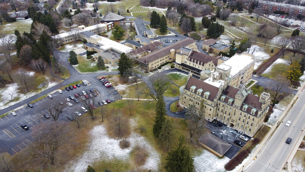 An aerial image taken with a drone shows the School Sisters of Notre Dame Central Pacific Province, Thursday, Dec. 17, 2020, in Elm Grove, Wis. Eight nuns living in the suburban Milwaukee covent have died in the last week from COVID-19, according to the congregation. (AP Photo/Morry Gash)