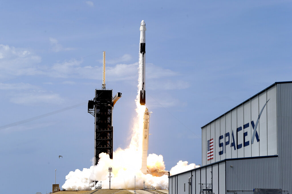 A SpaceX Falcon 9, with NASA astronauts Doug Hurley and Bob Behnken in the Dragon crew capsule, lifts off from Pad 39-A at the Kennedy Space Center in Cape Canaveral, Fla. on May 30, 2020. For the first time in nearly a decade, astronauts blasted towards orbit aboard an American rocket from American soil, a first for a private company. (AP Photo/John Raoux, File)