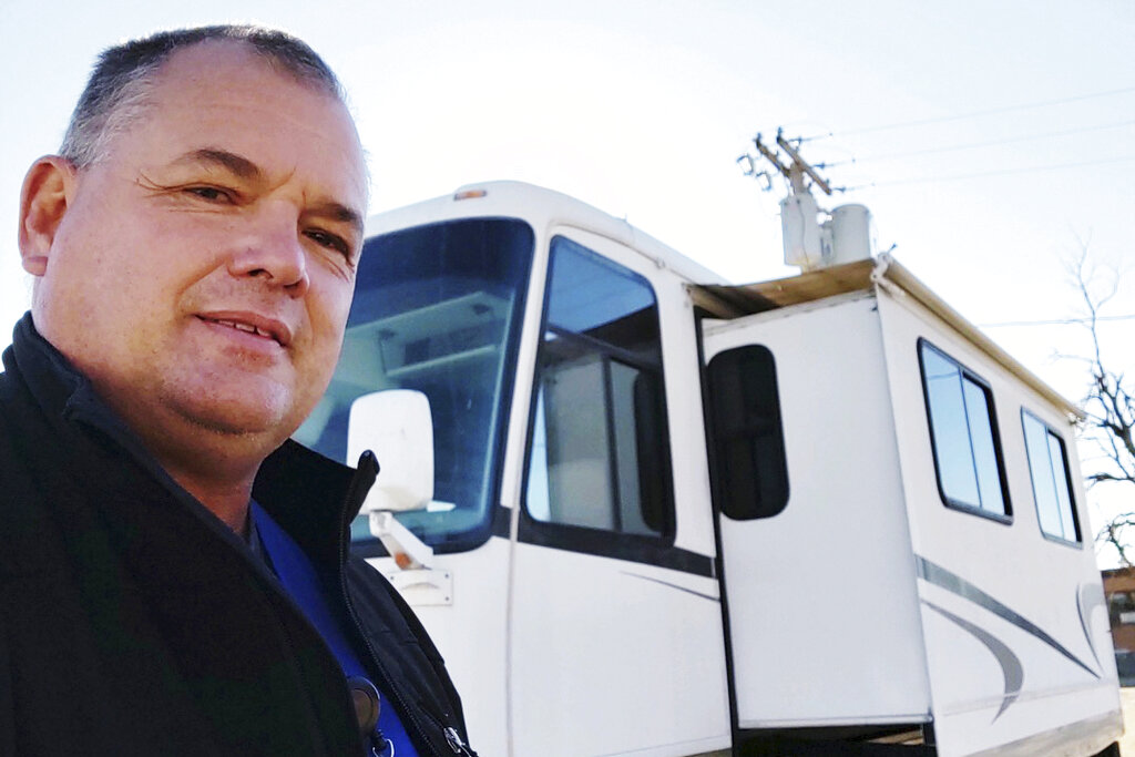 Eric Lewallen, a radiology technician, has been sleeping in an RV in the parking lot of his rural Kansas hospital because his co-workers are out sick with COVID-19 and no one else is available to take X-rays. (Eric Lewallen via The AP)