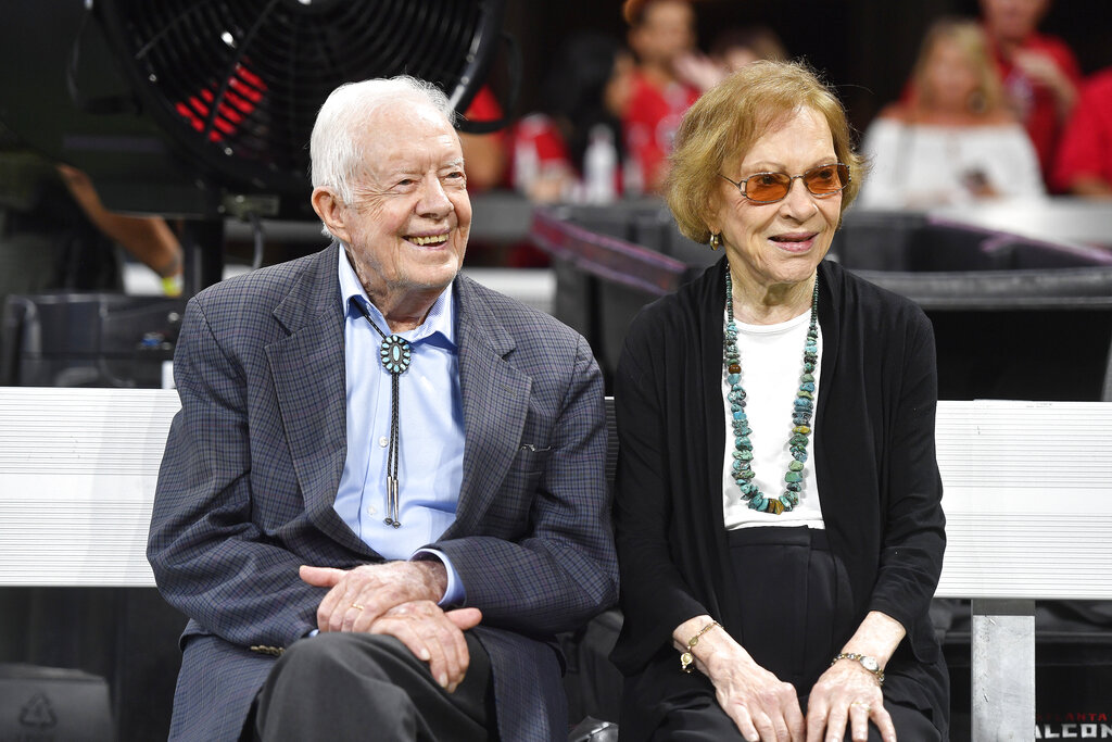 Former President Jimmy Carter and Rosalynn Carter at a football game between the Atlanta Falcons and the Cincinnati Bengals, in Atlanta in 2018. Former President Jimmy Carter and former first lady Rosalynn Carter will not attend President-elect Joe Biden's inauguration. It marks the first time the couple, 96 and 93, will have missed the ceremonies since Carter was sworn-in as the 39th president in 1977.(AP Photo/John Amis, File)