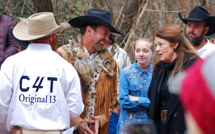 Cowboys for Trump leader and Otero County Commissioner Couy Griffin, center, talks with Republican New Mexico state Rep. Candy Ezzell of Roswell, N.M., at a protest against gun control and pro-abortion rights legislation outside the New Mexico State Capitol, in Santa Fe, N.M. in 2019. (AP Photo/Morgan Lee, File)