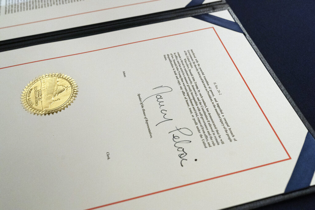 The signature of House Speaker Nancy Pelosi of Calif., is on the article of impeachment against President Donald Trump, after an engrossment ceremony before transmission to the Senate for trial on Capitol Hill, in Washington, Wednesday, Jan. 13, 2021. (AP Photo/Alex Brandon)