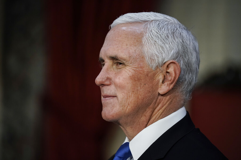 Vice President Mike Pence finishes a swearing-in ceremony for senators in the Old Senate Chamber at the Capitol in Washington, Sunday, Jan. 3, 2021. (AP Photo/J. Scott Applewhite, Pool)