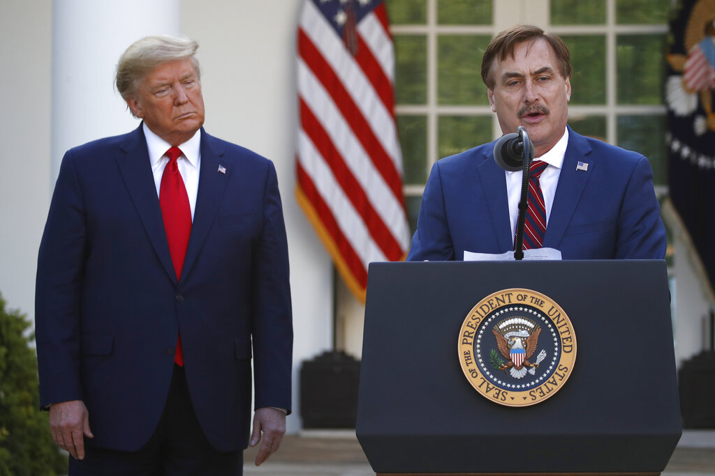 My Pillow CEO Mike Lindell speaks as President Donald Trump listens during a briefing about the coronavirus in the Rose Garden of the White House in March 2020. Twitter has permanently banned Lindell's Twitter account after he continually perpetuated the baseless claim that Donald Trump won the 2020 U.S. presidential election. (AP Photo/Alex Brandon, File)