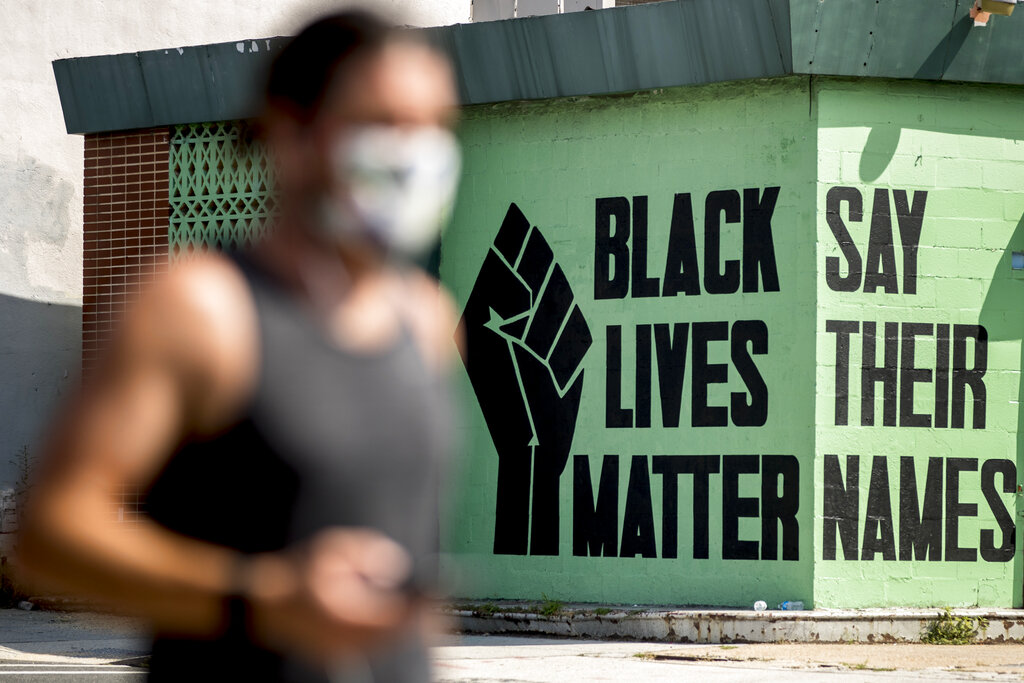 A black lives matter mural is visible in the Shaw neighborhood in Washington. The Black Lives Matter Global Network Foundation, which grew out of the creation of the Black Lives Matter movement, is formally expanding a $3 million financial relief fund that it quietly launched in February 2021, to help people struggling to make ends meet during the ongoing coronavirus pandemic. (AP Photo/Andrew Harnik, File)
