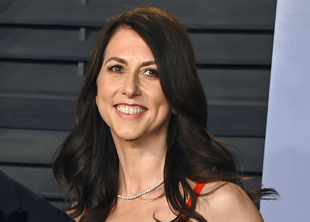 Then-MacKenzie Bezos arrives at the Vanity Fair Oscar Party in Beverly Hills, Calif. Scott, philanthropist, author and former wife of Amazon founder Jeff Bezos, has married a Seattle science teacher. Dan Jewett wrote in a letter to the website of the nonprofit organization the Giving Pledge, on Saturday, March 6, 2021, that he was grateful to be able to marry such a generous person and was ready to help her give away her wealth to help others. (Photo by Evan Agostini/Invision/AP, File)