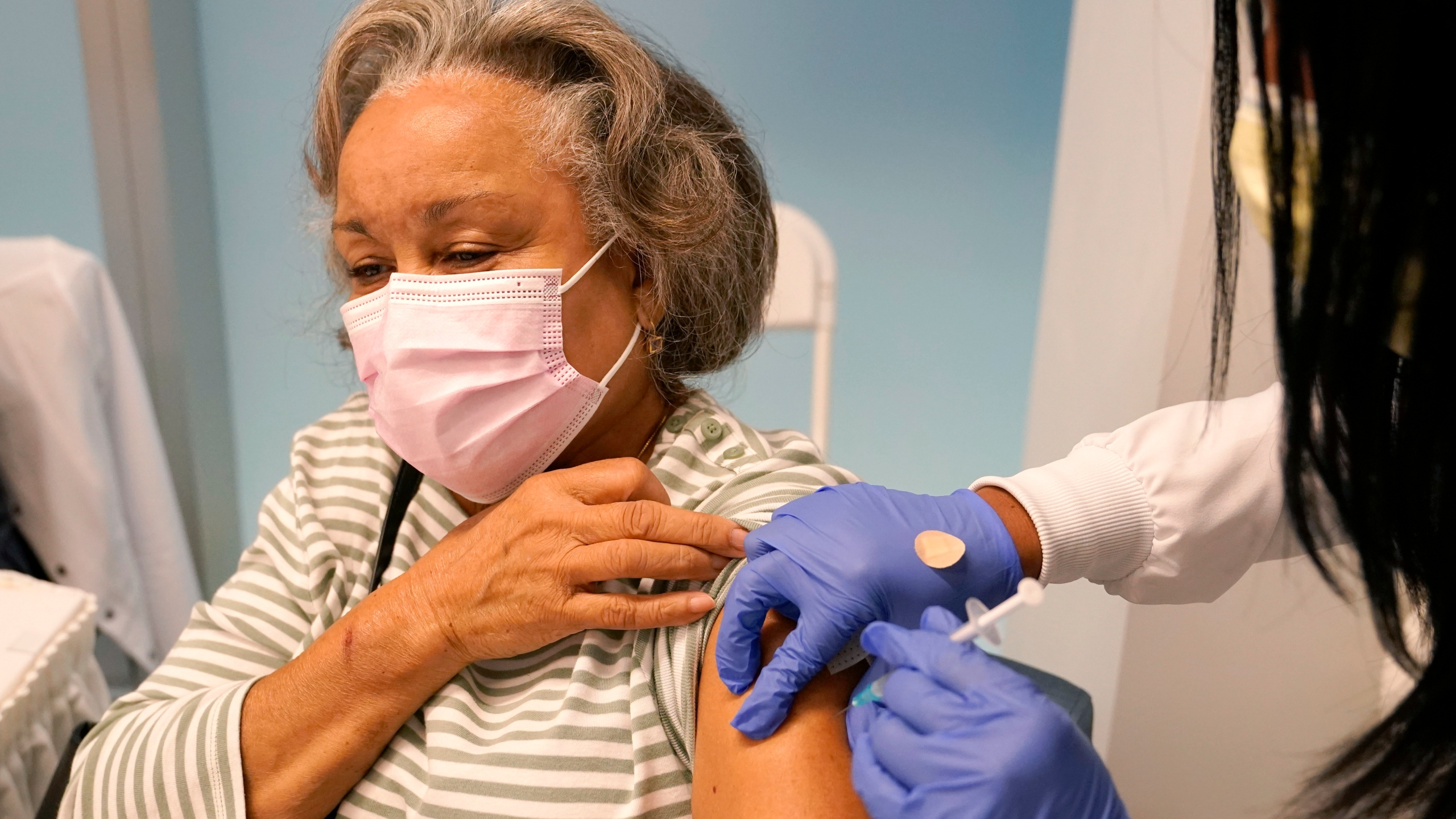 Irma Mesa, 74, receives the Pfizer-BioNTech COVID-19 vaccine at the Jackson Hospital in Miami on Jan. 27, 2021.. (AP Photo/Lynne Sladky, File)