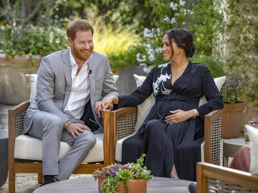 Prince Harry, left, and Meghan, Duchess of Sussex, speaking about expecting their second child during an interview with Oprah Winfrey. (Joe Pugliese/Harpo Productions via AP)