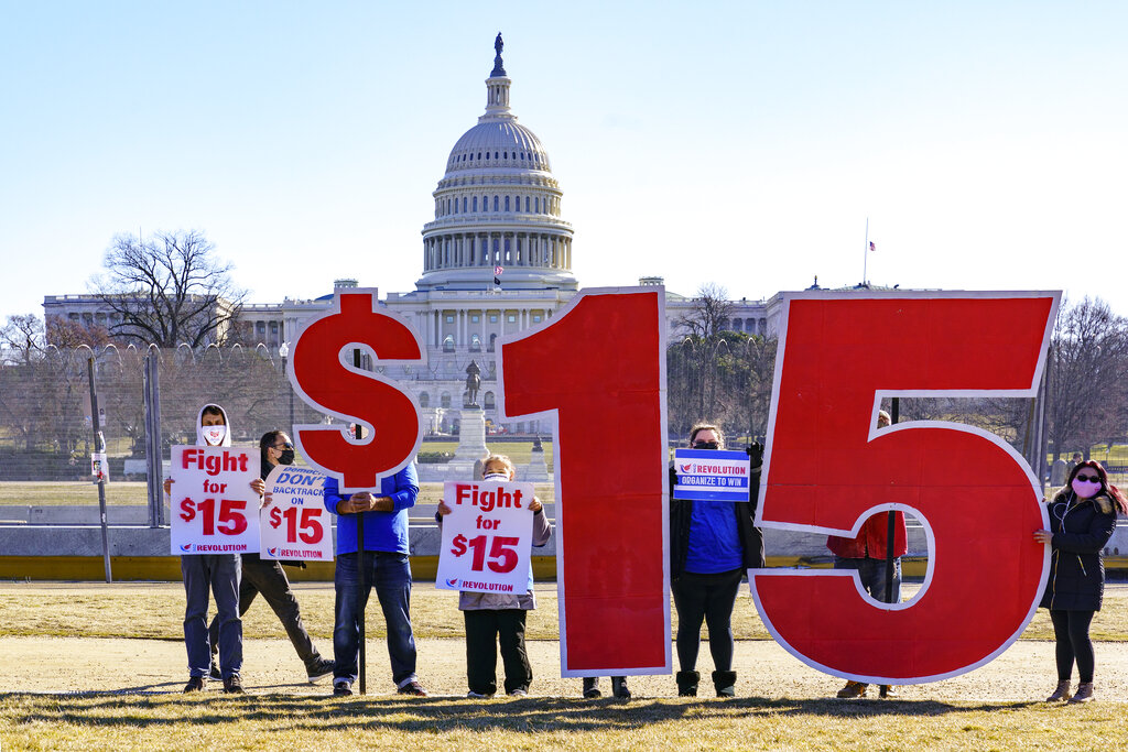 Activists appeal for a $15 minimum wage near the Capitol in Washington. (AP Photo/J. Scott Applewhite)