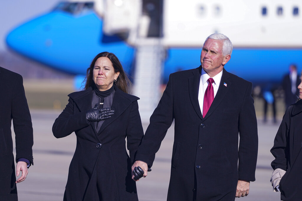 Former Vice President Mike Pence and his wife Karen walk from the plane to greet supporters after arriving back in his hometown of Columbus, Ind. after leaving office. Pence is steadily re-entering public life as he eyes a potential run for the White House in 2024. He's writing op-eds, delivering speeches, preparing trips to early voting states and launching an advocacy group likely to focus on promoting the accomplishments of the Trump administration. (AP Photo/Michael Conroy, File)