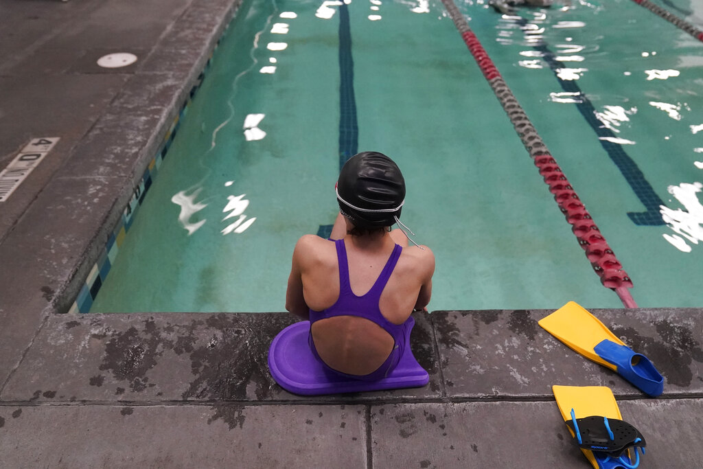 "A proposed ban on transgender athletes playing female school sports in Utah would affect transgender girls like this 12-year-old swimmer. She and her family spoke with The Associated Press on the condition of anonymity to avoid outing her publicly. She cried when she heard about the proposal that would ban transgender girls from competing on girls' sports teams in public high schools, which would separate her from her friends. She's far from the tallest girl on her team, and has worked hard to improve her times but is not a dominant swimmer in her age group, her coach said. ""Other than body parts I've been a girl my whole life,"" she said. (AP Photo/Rick Bowmer)"