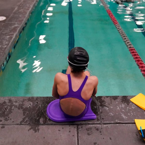 """A proposed ban on transgender athletes playing female school sports in Utah would affect transgender girls like this 12-year-old swimmer. She and her family spoke with The Associated Press on the condition of anonymity to avoid outing her publicly. She cried when she heard about the proposal that would ban transgender girls from competing on girls' sports teams in public high schools, which would separate her from her friends. She's far from the tallest girl on her team, and has worked hard to improve her times but is not a dominant swimmer in her age group, her coach said. """"Other than body parts I've been a girl my whole life,"""" she said. (AP Photo/Rick Bowmer)"""