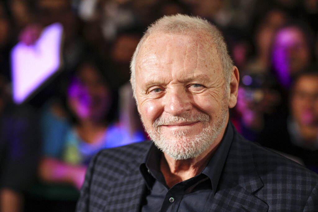 """Anthony Hopkins smiles while posing for photos prior to the premiere of his film """"The Rite"""" in Mexico City in 2011. The Oscars best actor trophy went to 83-year-old Anthony Hopkins for playing a man grappling with dementia in """"The Father."""" (AP Photo/Alexandre Meneghini, File)"""