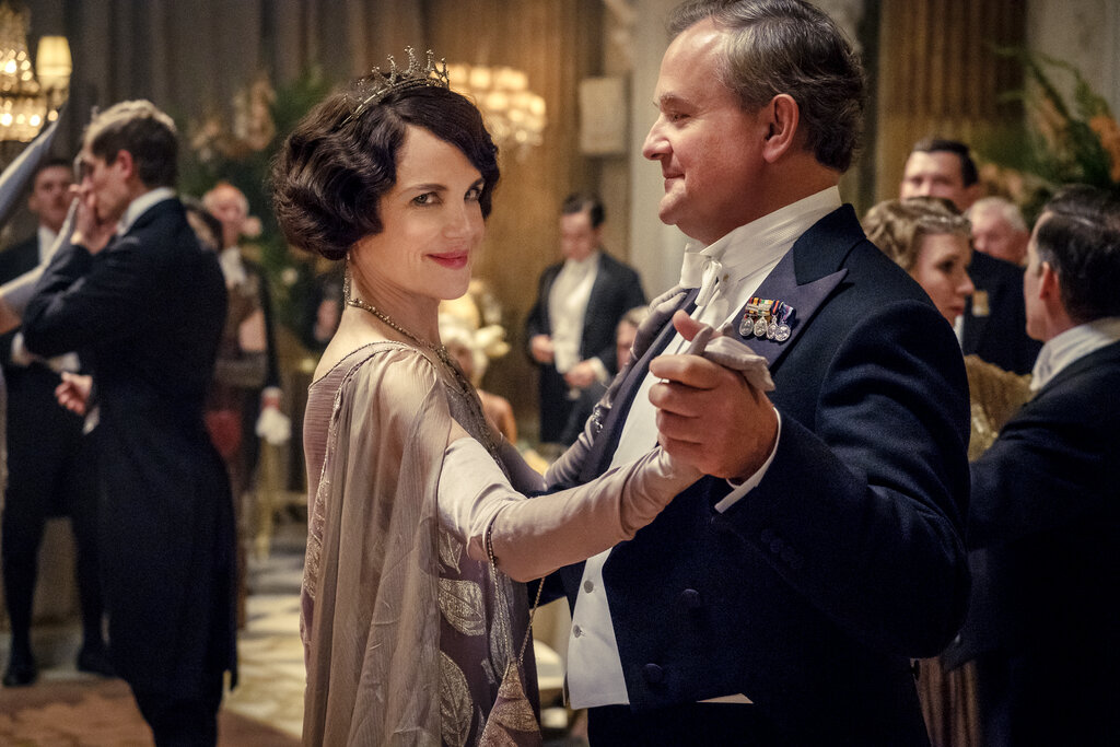 """Elizabeth McGovern, left, as Lady Grantham and Hugh Bonneville, as Lord Grantham, in """"Downton Abbey"""". The original principal cast of """"Downton Abbey"""" are returning for a second film that will arrive in theaters December 22 this year, Focus Features announced Monday. """"Downton Abbey"""" creator Julian Fellowes has written the screenplay, and Simon Curtis is directing. (Jaap Buitendijk/Focus Features via AP)"""