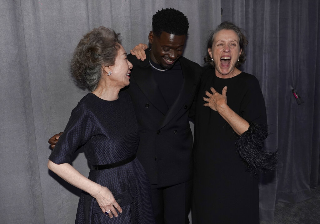 """Yuh-Jung Youn, left, winner of the award for best actress in a supporting role for """"Minari,"""" Daniel Kaluuya, winner of the award for best actor in a supporting role for """"Judas and the Black Messiah,"""" and Frances McDormand, winner of the award for best actress in a leading role for """"Nomadland,"""" pose outside the press room at the Oscars on Sunday, April 25, 2021, at Union Station in Los Angeles. (AP Photo/Chris Pizzello, Pool)"""