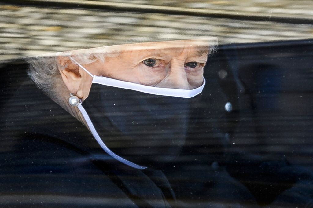 Queen Elizabeth II follows the coffin in a car as it makes it's way past the Round Tower during the funeral of Britain's Prince Philip inside Windsor Castle in Windsor, England. Now that the Royal Family has said farewell to Prince Philip, attention will turn to Queen Elizabeth II's 95th birthday on Wednesday, April 21 and, in coming months, the celebrations marking her 70 years on the throne. This combination of events is reminding the United Kingdom that the reign of the queen, the only monarch most of her subjects have ever known, is finite. (Leon Neal/Pool via AP, file)