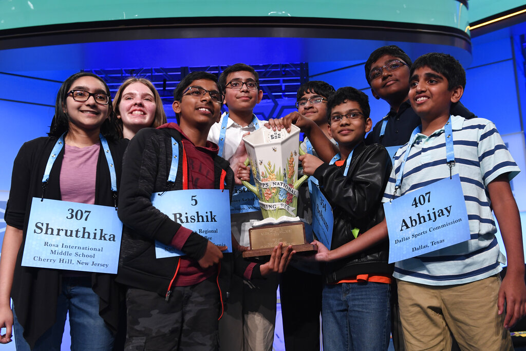 The eight co-champions of the 2019 Scripps National Spelling Bee, from left, Shruthika Padhy, 13, of Cherry Hill, N.J., Erin Howard, 14, of Huntsville, Ala., Rishik Gandhasri, 13, of San Jose, Calif., Christopher Serrao, 13, of Whitehouse Station, N.J., Saketh Sundar, 13, of Clarksville, Md., Sohum Sukhatankar, 13, of Dallas, Texas, Rohan Raja, 13, of Irving, Texas, and Abhijay Kodali, 12, of Flower Mound, Texas, hold the trophy at the end of the competition in Oxon Hill, Md. The Scripps National Spelling Bee is undergoing a major overhaul to ensure it can identify a single champion, adding vocabulary questions and a lightning-round tiebreaker to this year's pandemic-altered competition, Friday, April 23, 2021. (AP Photo/Susan Walsh, File)