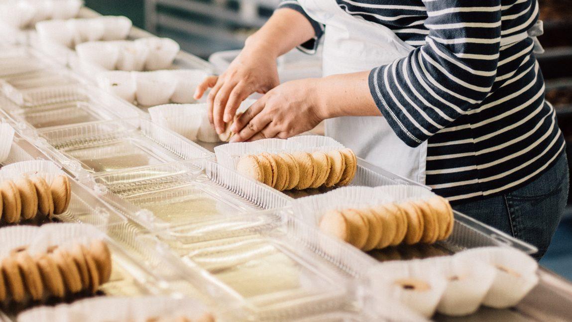 Bakery Woman Arranging Cookies