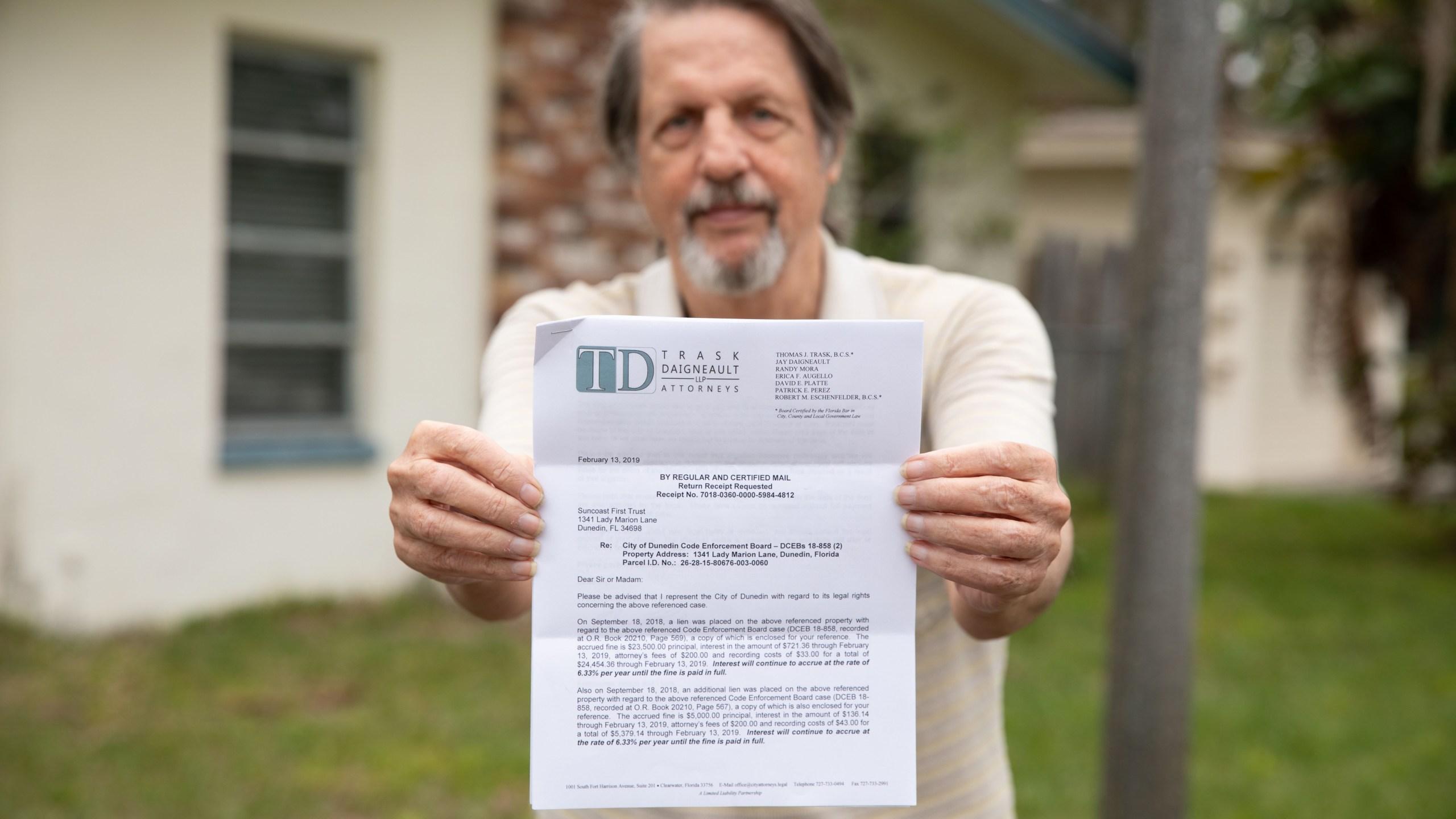 Jim Ficken fined for overgrown grass Dunedin Florida