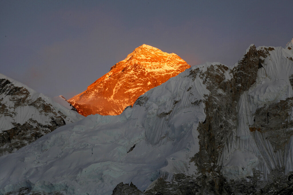 """Mt. Everest is seen from the way to Kalapatthar in Nepal. China will draw a """"separation line"""" atop Mount Everest to prevent the coronavirus from being spread by climbers ascending Nepal's side of the mountain, Chinese state media reported Monday. (AP Photo/Tashi Sherpa, File)"""