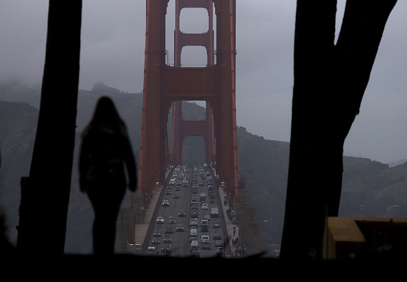 A visitor takes in view of the Golden Gate Bridge on December 13, 2019 in San Francisco, California. Installation of the the Golden Gate Bridge suicide prevention net has been delayed at least two years due to issues with the lead contractor on the job. The installation was scheduled to be completed in 2021 but is now expected to be completed by 2023. (Photo by Justin Sullivan/Getty Images)