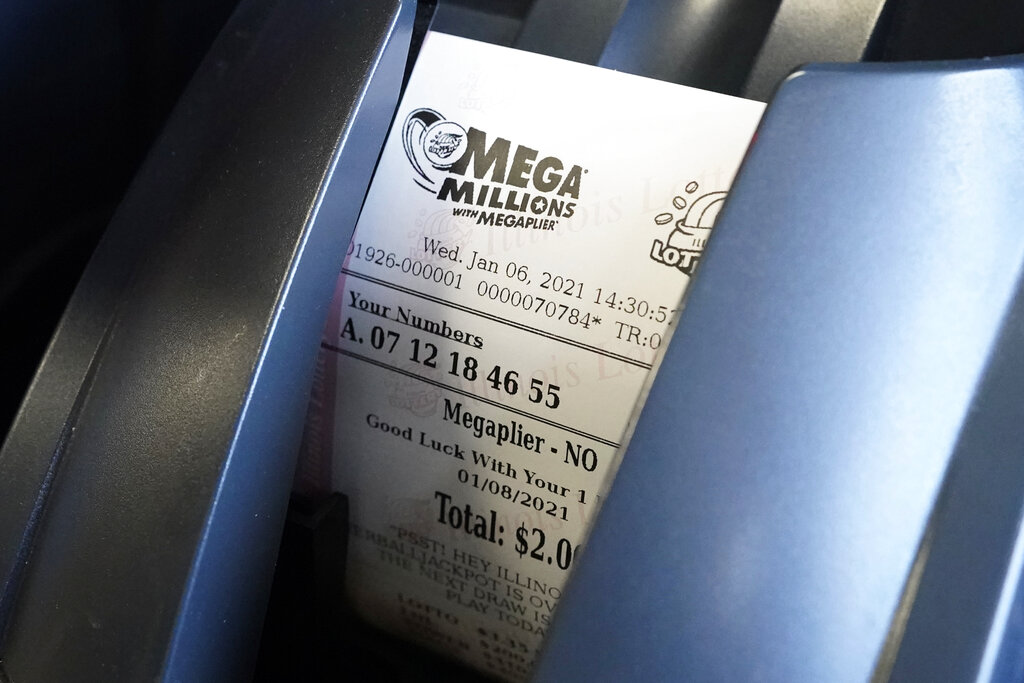 A Mega Millions lottery ticket in a lottery machine at a convenience store in Northbrook, Ill. (AP file/Nam Y. Huh)