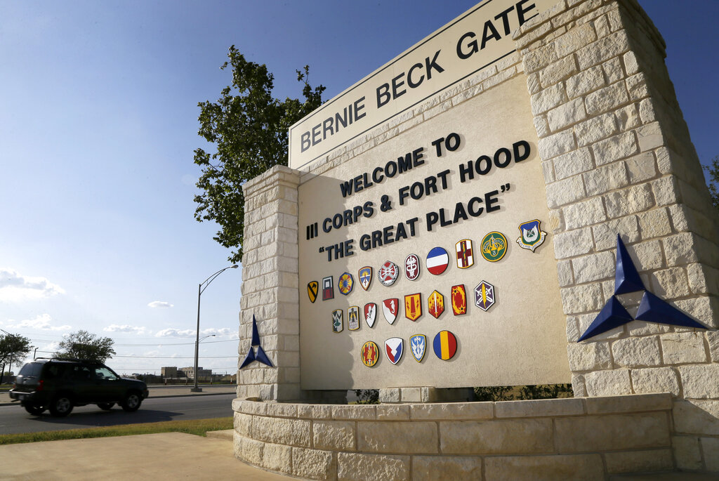 Traffic flows through the main gate past a welcome sign in Fort Hood, Texas. A new study finds that female soldiers at Army bases in Texas, Colorado, Kansas and Kentucky face a greater risk of sexual assault and harassment than those at other posts, accounting for more than a third of all active duty Army women sexually assaulted in 2018. The study by RAND Corporation was released Friday. (AP Photo/Tony Gutierrez, File)