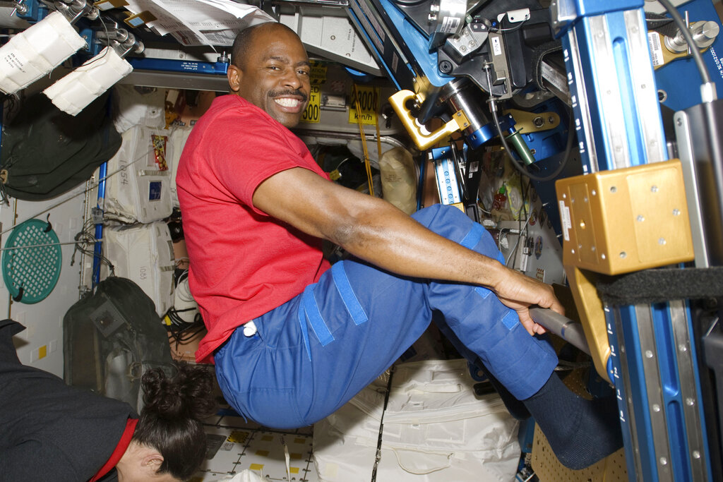 Astronaut Leland Melvin exercises in the Unity module of the International Space Station in 2009. Astronauts exercise two hours every day to counter the muscle- and bone-withering effects of weightlessness, quickly leaving their workout clothes sweaty, smelly and stiff. Their T-shirts, shorts and socks end up so foul that they run through a pair every week, according to Melvin, a former NASA astronaut and NFL player. (NASA via AP)