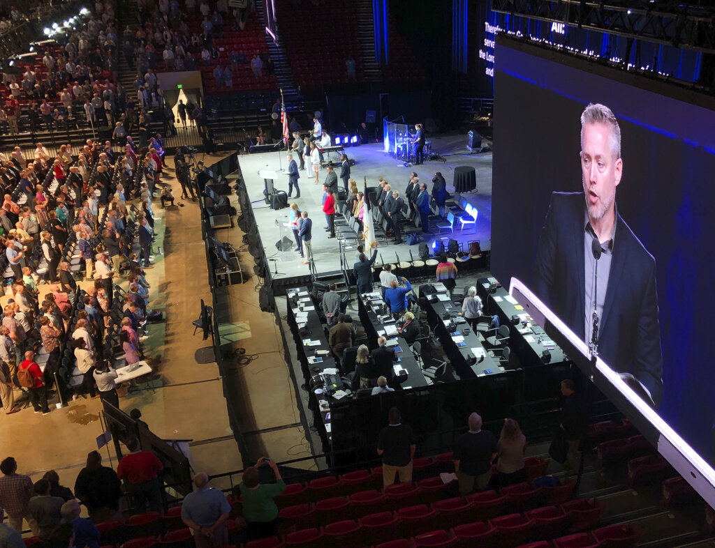 J.D. Greear, president of the Southern Baptist Convention, is shown on a video screen as he addresses the denomination's annual meeting in Birmingham, Ala. in 2019. As Southern Baptists prepare for their biggest annual meeting in more than a quarter-century in June 2021, accusations that leaders have shielded churches from claims of sexual abuse and simmering tensions around race threaten to once again mire the nation's largest Protestant denomination in a conflict that can look more political than theological. (AP Photo/Jay Reeves, File)