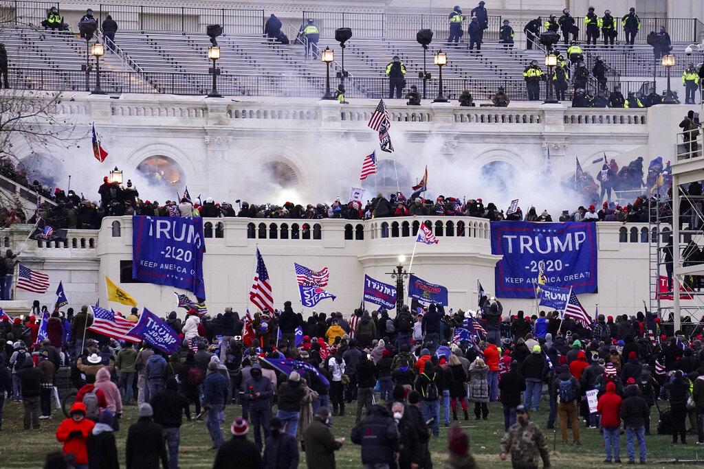 Violent rioters storm the Capitol on Jan. 6. (AP Photo/John Minchillo, File)