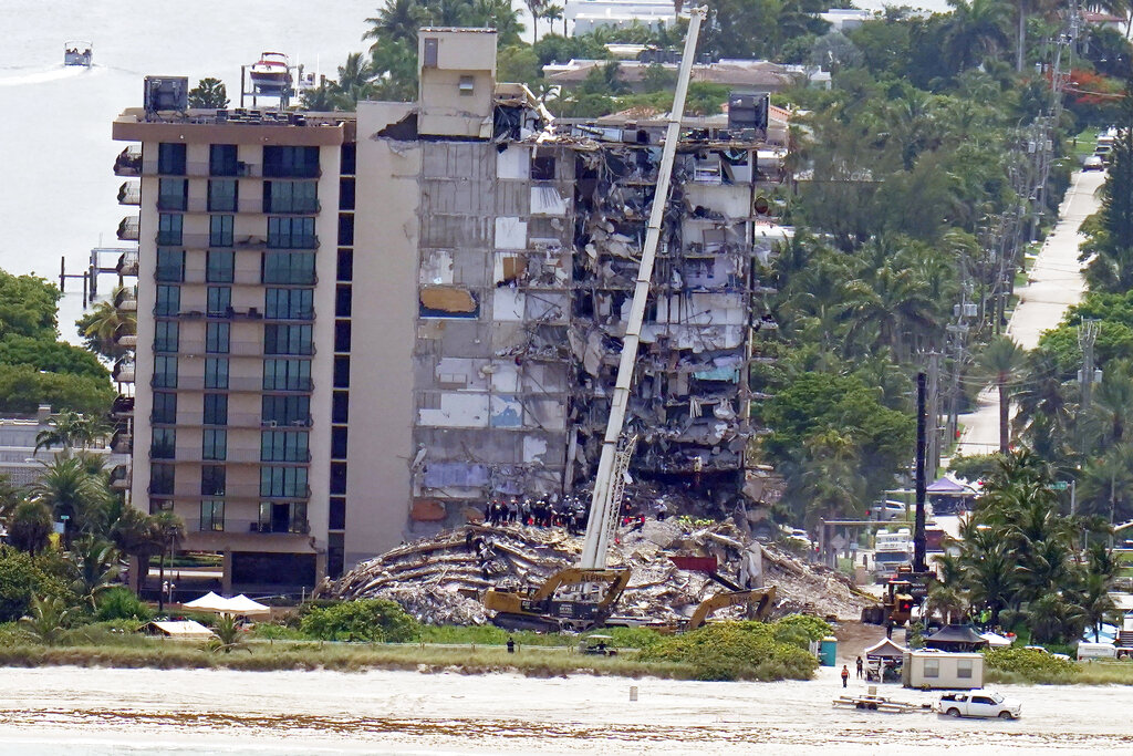 Workers search the rubble at the Champlain Towers South Condo. (AP Photo/Gerald Herbert)