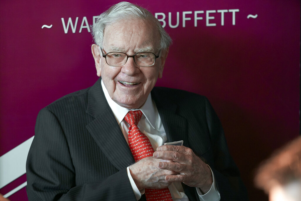 Warren Buffett, Chairman and CEO of Berkshire Hathaway, smiles as he plays bridge following the annual Berkshire Hathaway shareholders meeting in Omaha, Neb. in 2019. Warren Buffett made a $4.1 billion annual philanthropic contribution and said he's halfway through his goal of giving away most of his money. The billionaire investor also said he is stepping down as trustee of the Bill and Melinda Gates Foundation as he exits all other corporate boards. (AP Photo/Nati Harnik, File)