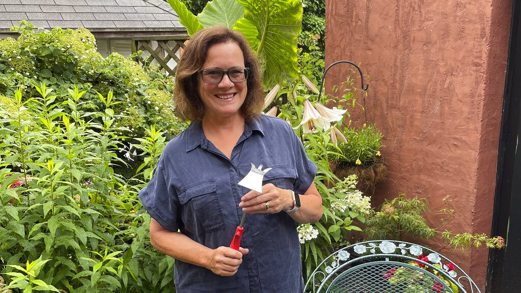 """Elizabeth Licata, moderator of the Facebook group, WNY Gardeners, poses for a photograph in Buffalo, N.Y. Moderating a Facebook gardening group is not without challenges. Facebook's algorithms sometimes flag the word """" hoe"""" as """"violating community standards,"""" apparently referring to a different word, one without an """"e"""" at the end that is nonetheless often misspelled as the garden tool. Licata said it has been futile trying to reach Facebook to correct the mistake. (Elizabeth Licata via AP)"""