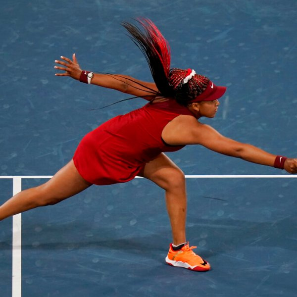 Naomi Osaka reaches for a shot by Marketa Vondrousova during the third round of the tennis competition at the 2020 Summer Olympics, Tuesday, July 27, 2021, in Tokyo, Japan. (AP Photo/Seth Wenig)