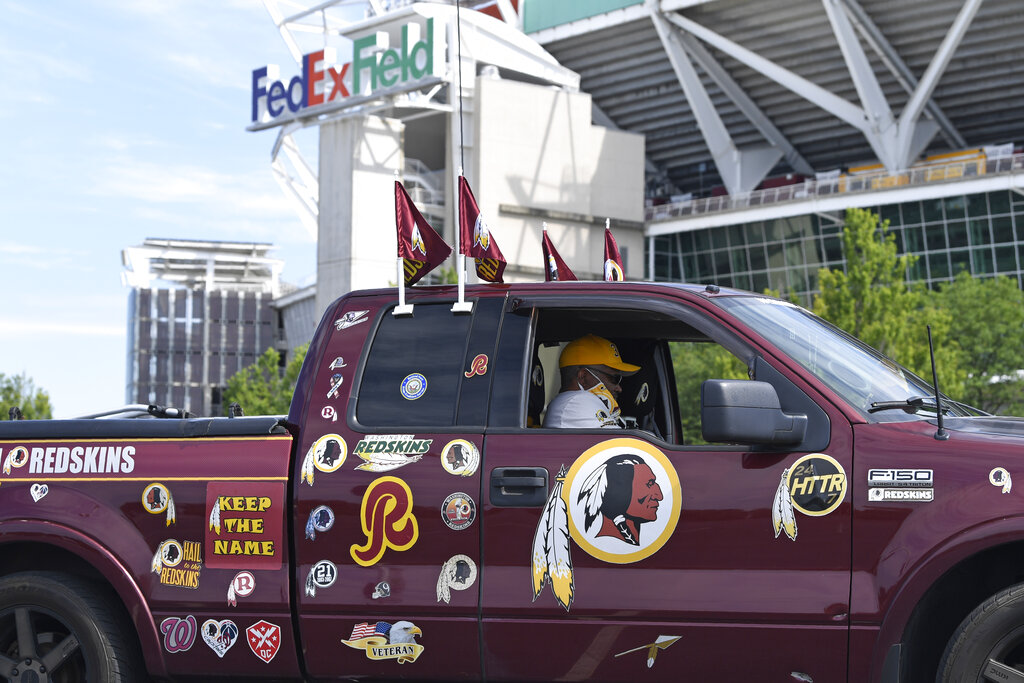 Johnson of Chesapeake, Va., sits in his truck outside FedEx Field in Landover, Md. in 2020. Washington's NFL team will not be called the Warriors or have any other Native American imagery in the new name when it's revealed next year. (AP Photo/Susan Walsh, File)