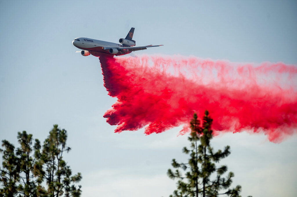 A DC-10 air tanker drops retardant while battling the Salt Fire near the Lakehead community of Unincorporated Shasta County, Calif. Airport officials facing jet fuel shortages are concerned they'll have to wave off fire retardant bombers and helicopters when wildfire season heats up, potentially endangering surrounding communities. (AP Photo/Noah Berger, File)
