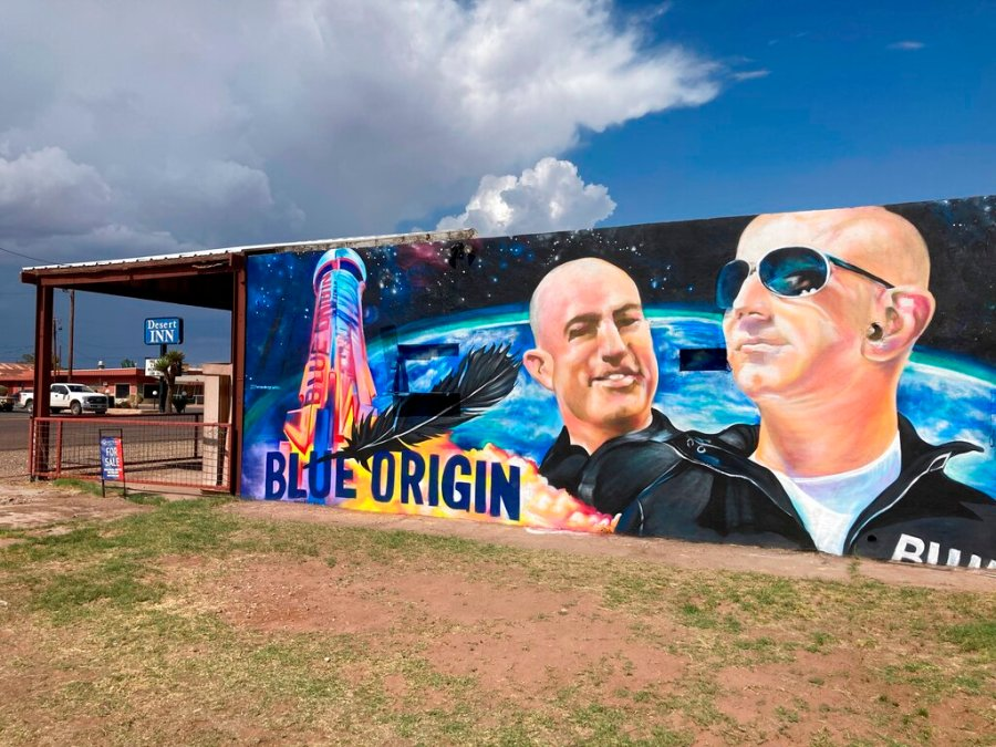 The side of a building in Van Horn, Texas, is adorned with a mural of Blue Origin founder Jeff Bezos. (AP Photo/Sean Murphy)