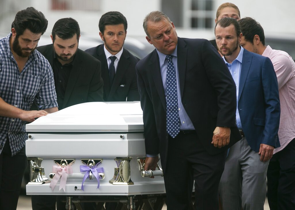 Pallbearers wheel the casket of Lucia Guara and Emma Guara as they arrive to their funeral service at St. Joseph Catholic Church in Miami Beach, Fla. Lucia, Emma, their father, Marcus Guara, and mother, Emma Rodriguez all died during the Champlain Towers South condo collapse on June 24. (Matias J. Ocner /Miami Herald via AP)