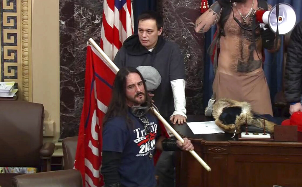 In this file image from U.S. Capitol Police video, Paul Allard Hodgkins, 38, of Tampa, Fla., stands in the well on the floor of the U.S. Senate. (U.S. Capitol Police via AP, File)