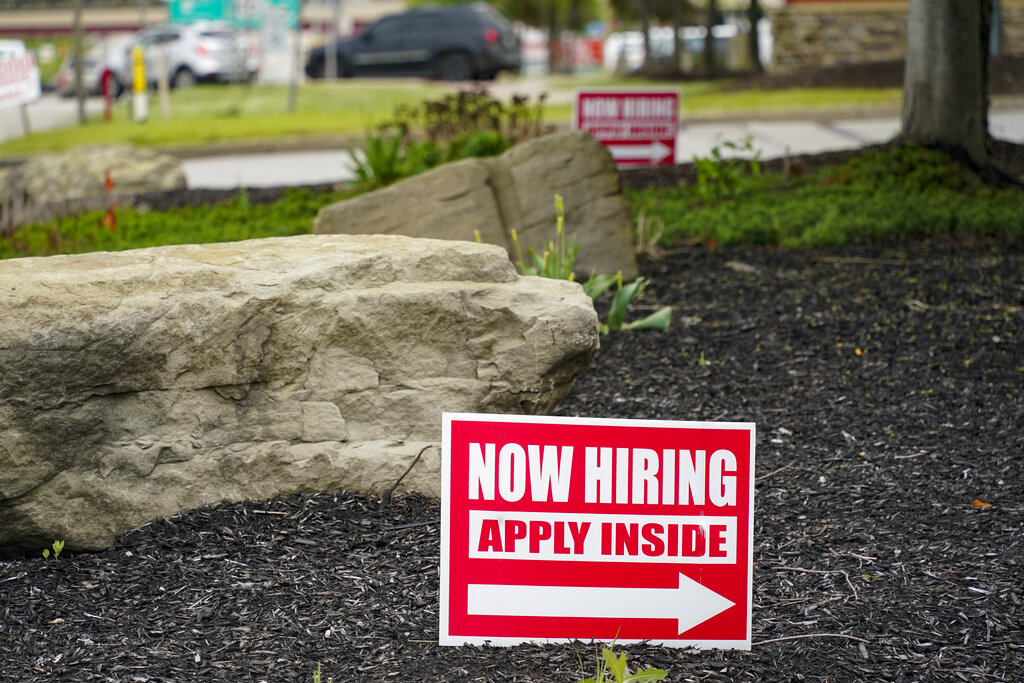A gas station in Cranberry Township, Butler County, Pa. The number of Americans applying for unemployment benefits dropped last week, reported Thursday, June 24, a sign that layoffs declined and the job market is improving. (AP Photo/Keith Srakocic)