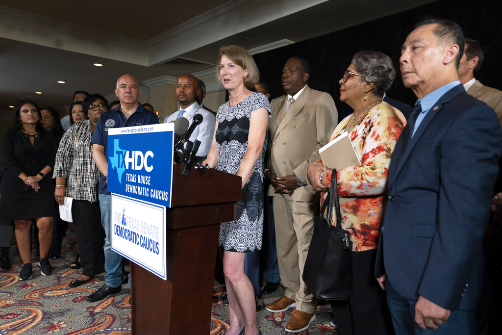 Democratic Texas State Rep. Vikky Goodwin, center, from Austin, together with her fellow Texas legislators, speaks during a news conference, Wednesday, July 14, 2021, in Washington. (AP Photo/Manuel Balce Ceneta)
