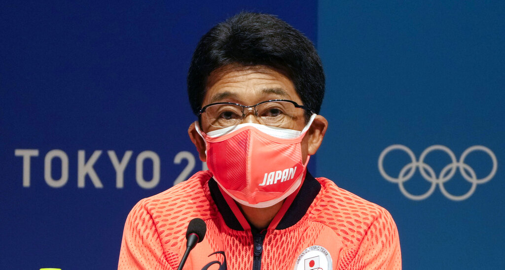 Japanese delegation head Tsuyoshi Fukui talks to the media during a press conference of the Japanese Olympic committee prior the 2020 Summer Olympics, Tuesday, July 20, 2021, in Tokyo. (AP Photo/Martin Meissner)