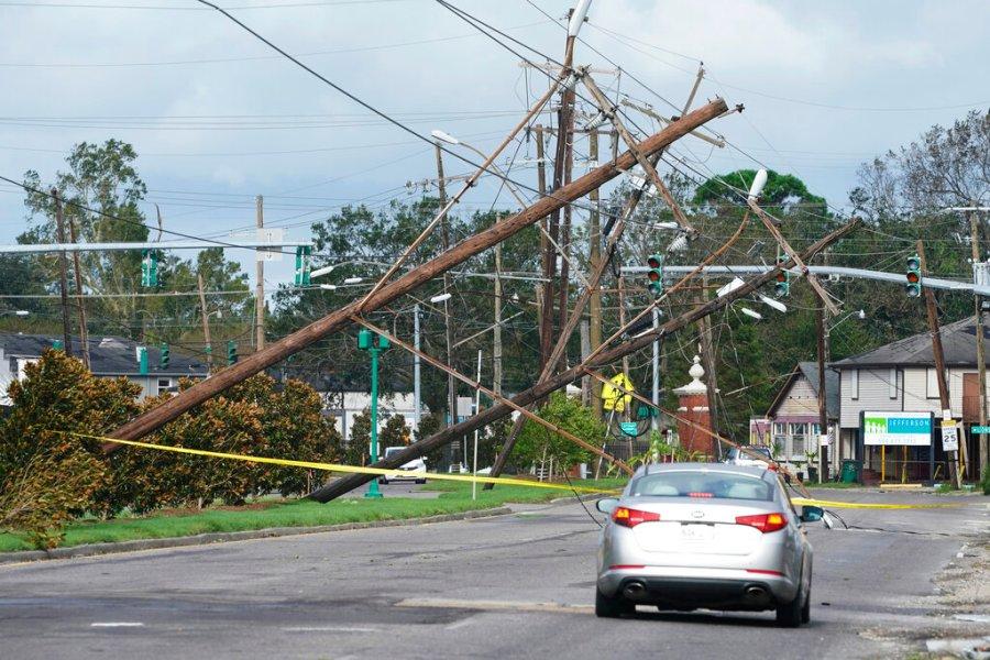 Traffic diverts around downed power lines in Metairie, La. (AP Photo/Steve Helber)