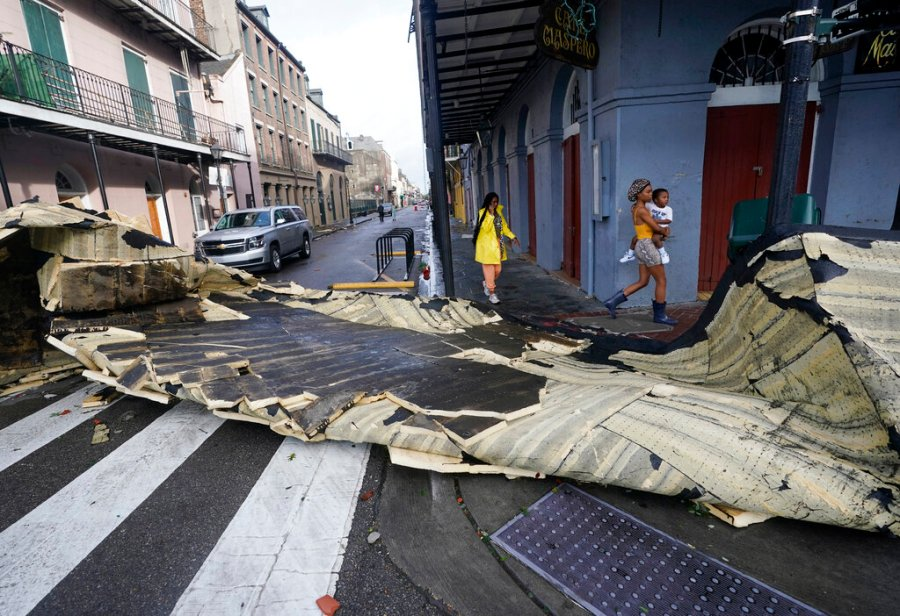 A section of roof that was blown off of a building in the French Quarter by Hurricane Ida winds blocks an intersection, Monday, Aug. 30, 2021, in New Orleans, La. (AP Photo/Eric Gay)