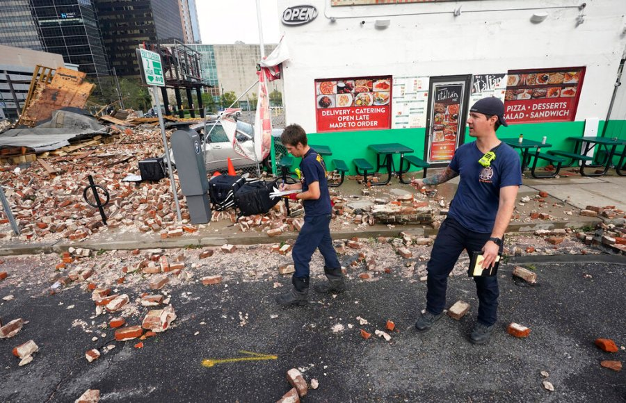New Orleans Firefighters assess damage as they look through debris after a building collapsed from the effects of Hurricane Ida, Monday, Aug. 30, 2021, in New Orleans, La. (AP Photo/Eric Gay)